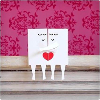 Paper Couple on a Shelf