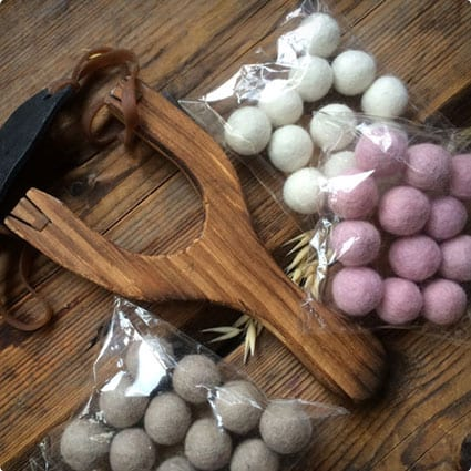 Wooden slingshot with 12 felt ball ammunition
